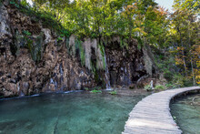 Wooden Footbridge Over Picturesque Lake