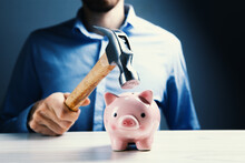 A Sad Pink Piggy Bank Is About To Be Hit By A Hammer In Old Vintage Tone  Financial Problem