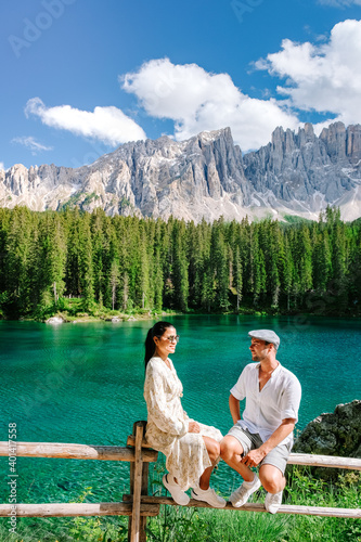 Fotomural couple men and woman on vacation in the Italian Dolomites Italy