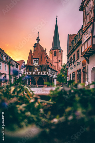Obraz The beautiful historic village in Hessen Germany is called Michelstadt. Here you can see part of the old town with its Gothic half-timbered houses, the wheel house in the sunrise in the morning  - fototapety do salonu