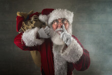 Santa Claus Laying A Finger Aside Of His Nose In The Chimney