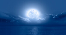 """Night Sky With Moon In The Clouds On The Foreground Blue Sea """"Elements Of This Image Furnished By NASA"""