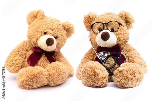 Brown doctor teddy bear with eye glasses and medical stethoscope  with patient isolated on white background. #401472784