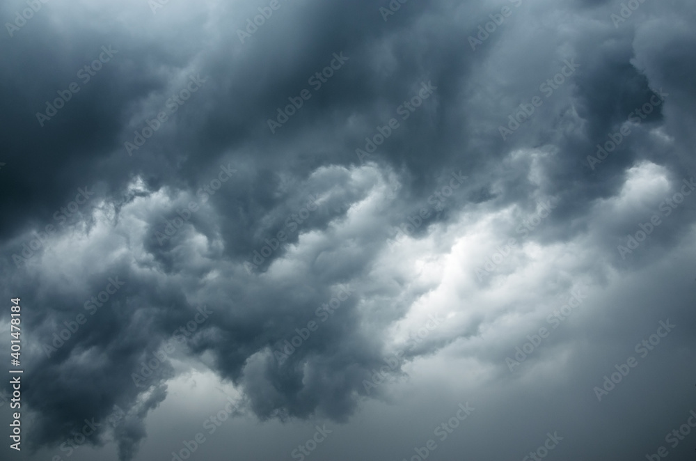 Fototapeta Background of dark stormy ominous clouds in gray moody sky