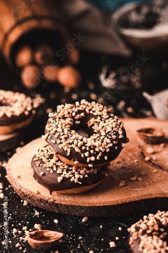 Obraz Chocolate nut donuts with beautiful home background - fototapety do salonu