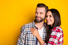 Portrait Of Attractive Tender Cheerful Couple Embracing Looking Aside Copy Space Isolated Over Bright Yellow Color Background