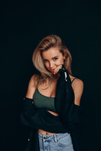 Photoshoot Of A Blonde In A Black Bra And Jeans. Studio Photography.