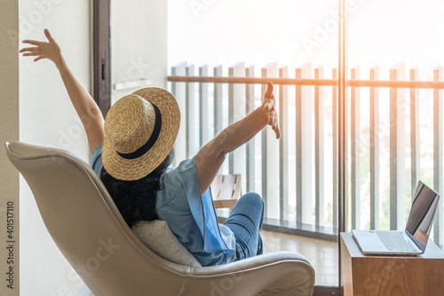 Fototapeta Life balance and summer holiday vacation concept with happy woman taking a break