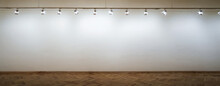 Interior Of A Empty White Wall With Spot Lights At Art Gallery