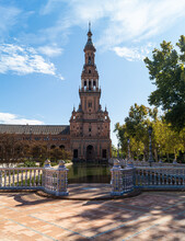 South Tower Of The Plaza De España In Seville Next To The María Luisa Park (Andalusia, Spain). Landmark Of The City Photographed On A Sunny Autumn Day.