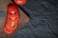 High Angle View Of Freshly Picked, Juicy Tomatoes On Dark Stone Background