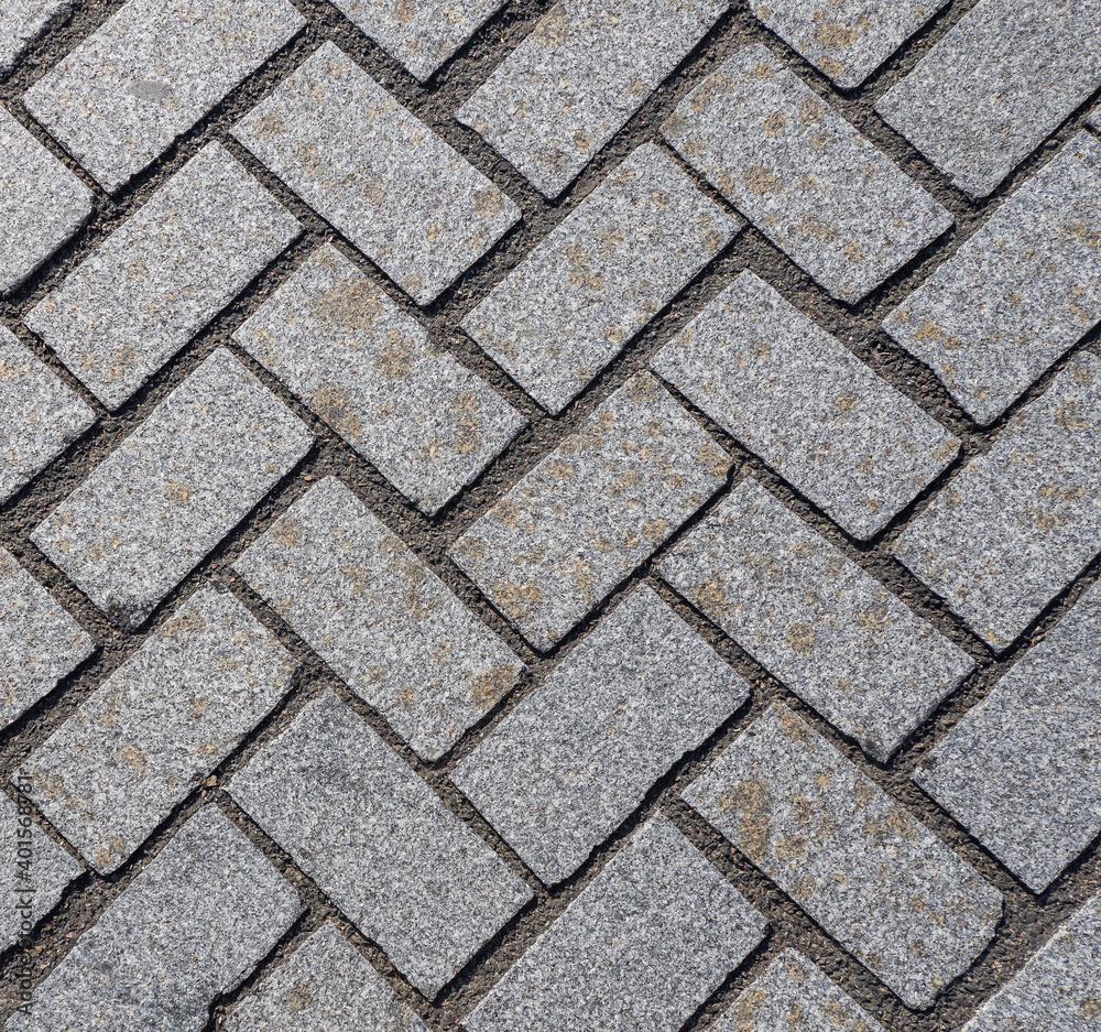 Fototapeta Grey pavement texture. Inclined rectangles.