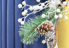 Christmas Composition With Snow-covered Pine Cone, Pine Branch And White Shiny Balls.