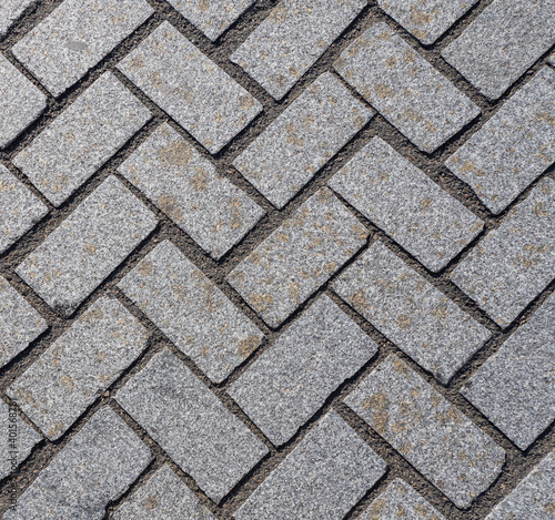 Grey pavement texture. Inclined rectangles. Wallpaper Mural