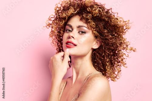 Woman portrait Curly hair, bare shoulders bright makeup