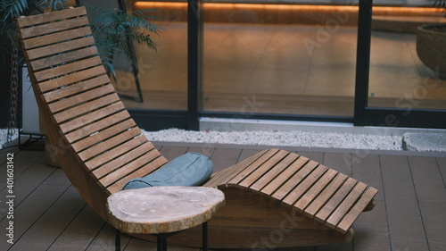 natural wooden deck chair with side table Fototapete