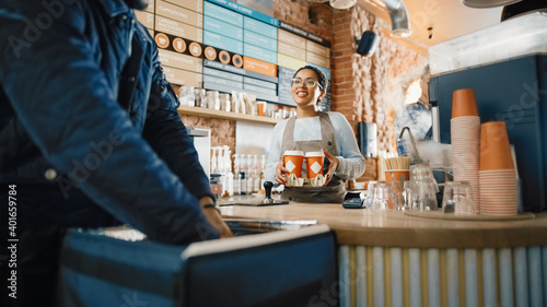 Beautiful Happy Latin Barista Serves Order of a Food Delivery Courier and Passing Cardboard Cupholder with Two Take Away Coffees Poster Mural XXL