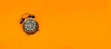 Alarm 7 O' Clock On Orange Background