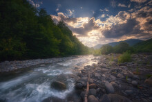 Beautiful Sunset Over Fast Flowing Mountain River