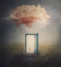 Surreal Scene, Teleportation Concept, Time And Space Traveling Through A Open Door On A Mystic Land. Magic Cloud In The Sky, Mysterious Lightnings And A Wanderer Person Silhouette In The Mist.