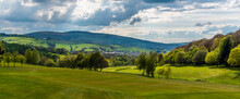 A Panorama View From The Snake Pass Looking Down Towards The Town Of Glossop, UK In Springtime