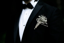Black Dress With Flower In The Lapel Groom