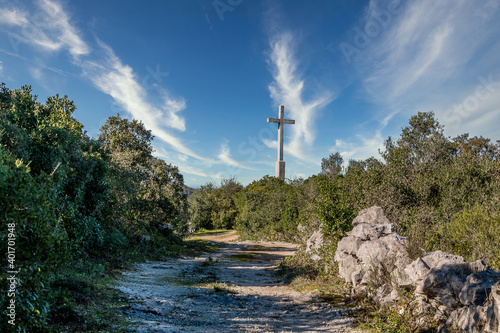 Catholic monument of the cross in the middle of the moutains. Serra de Aire, Portugal.