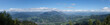 A panoramic shot of the beautiful Bavarian Alps surrounded by clouds captured in Germany