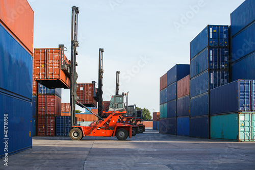 Fotografie, Obraz Container loading in container yard with container handlers