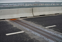 A Closeup Of An Expansion Joint On A Bridge