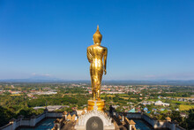 The Standing Golden Buddha At A Hill Or Valley At Wat Phra That Khao Noi,Nan Thailand.