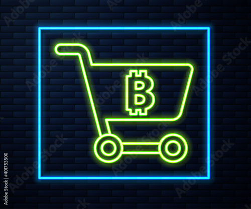 Foto Glowing neon line Shopping cart with bitcoin icon isolated on brick wall background