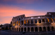 The Colosseum With Sunset Scene And  The Night At Rome, Italy. Which  The Architecture And Landmark. Rome Colosseum Is One Of The Main Attractions Of Rome In Italy