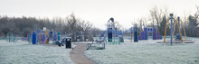 Play Park Outdoors With Frozen Grass During Winter