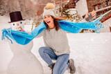 Fototapeta Natura - young happy blogger girl in snow in the alps
