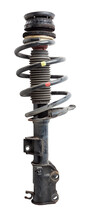 Shock Absorber Struts With Black Springs After Being Used On A Car During Replacement And Repair On A White Isolated Background. Used Spare Parts. Auto Parts Catalog.