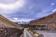 View From Hilly Mountain Road  Travelling To Chandrataal Lake Through Gully Eroded Geological Landform Prominent In Cold Desert Of Spiti Valley Due To Barren Steep Slopes And Weak Geological Mud Rocks