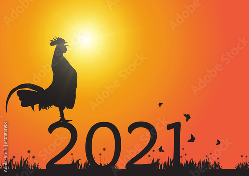 Leinwand Poster Silhouette of chicken crowing on number 2021 on sunrise background, new year cel