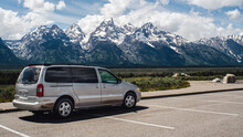 Campervan Parked With A View Of Large Mountains Grand Tetons