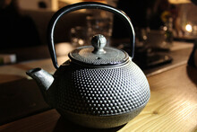 A Selective Focus Shot Of A Cast-iron Kettle