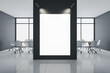canvas print picture - Spacious conference interior with blank backlit vertical poster.
