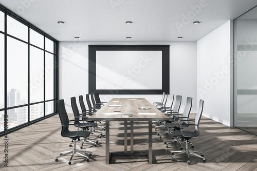 Obraz Bright meeting room interior with blank billboard on wall. - fototapety do salonu