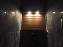 Wooden And Cement Wall With Lights Around In The Darkness