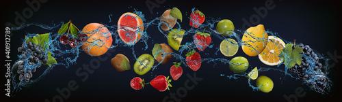 Vászonkép Panorama with fruits in water - juicy grapes, cherries, grapefruit, kiwi, strawb