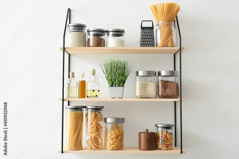 Fototapeta Set of jars with products on kitchen shelves