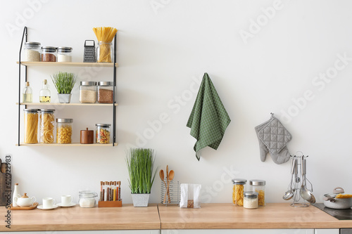 Fototapeta Utensils with products on counter in kitchen obraz
