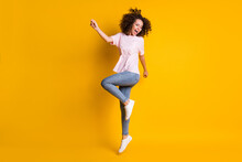 Photo Portrait Full Body View Of Girl Jumping Up On One Leg Screaming Isolated On Vivid Yellow Colored Background