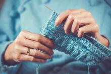 Close Up The Woman's Hands Knitting A Blue Woolen Sweater