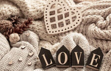 Cozy Composition With Knitted Elements And Wooden Decorative Word Love.
