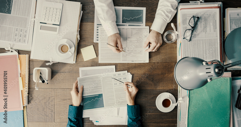 Fototapeta Business people working together and checking financial charts